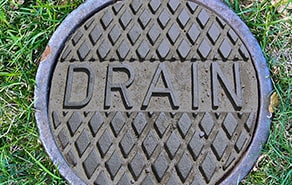 cap for sewer and drain cleaning on lawn
